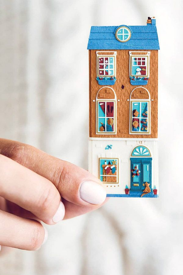 miniature three story paper cut house decorated for Christmas