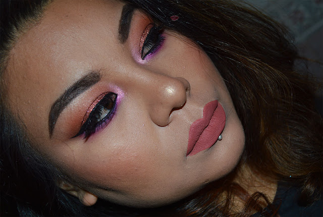 A picture of a makeup look using Desert Dusk Palette by HUda Beauty