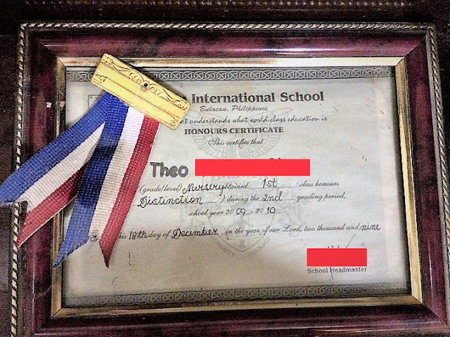 Theo's 1st class honors distinction medal and certificate in Nursery (regular school)