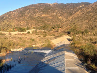 Water flowing over a check dam on the San Gabriel River near Fish Canyon