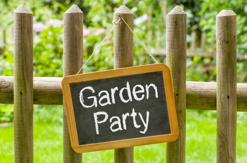 Garden party sign on wooden gate