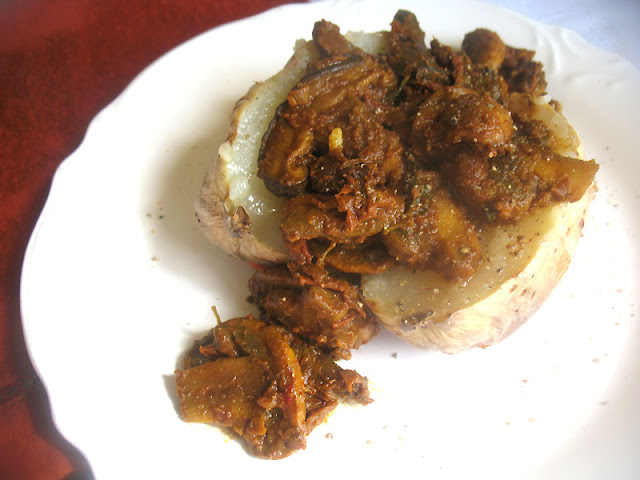 Spicy Mushroom Curry served over a Baked Potato