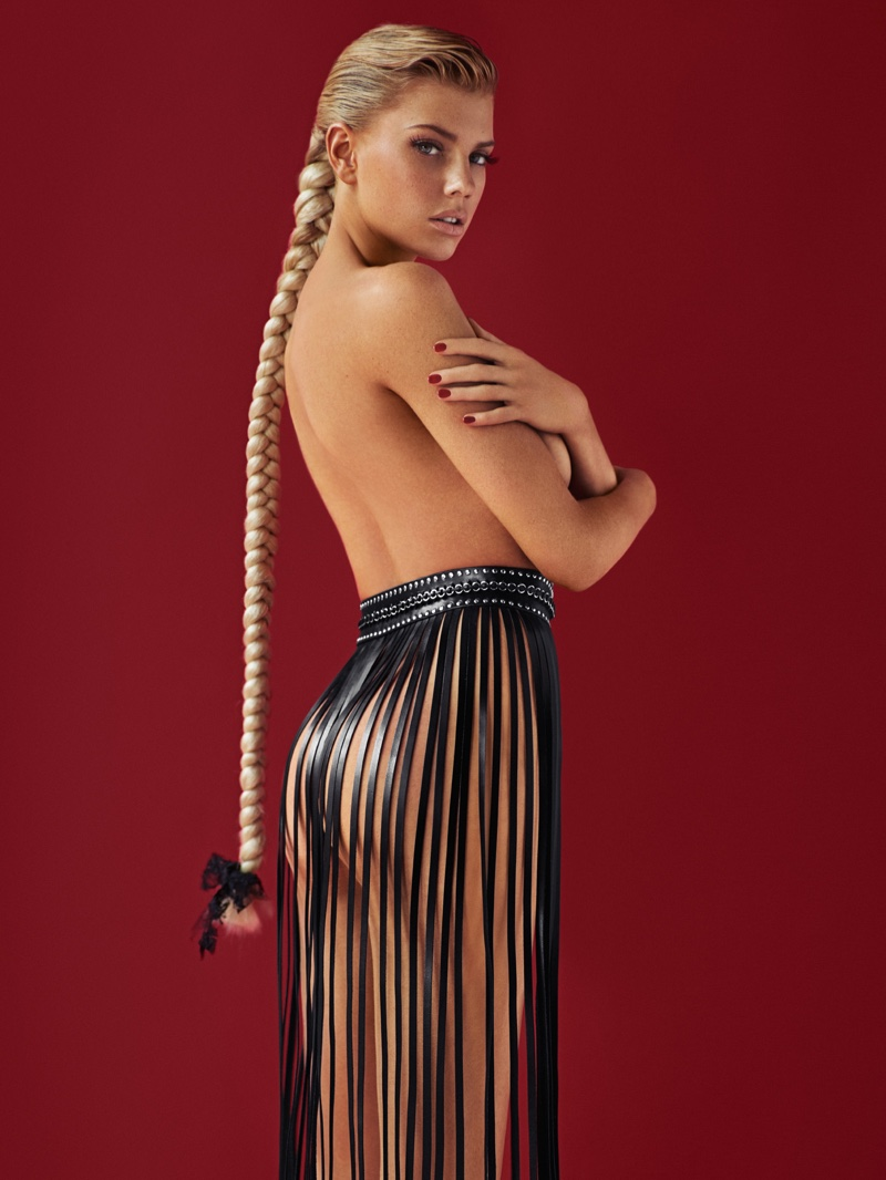 Charlotte models a fringe skirt with a braided hairstyle