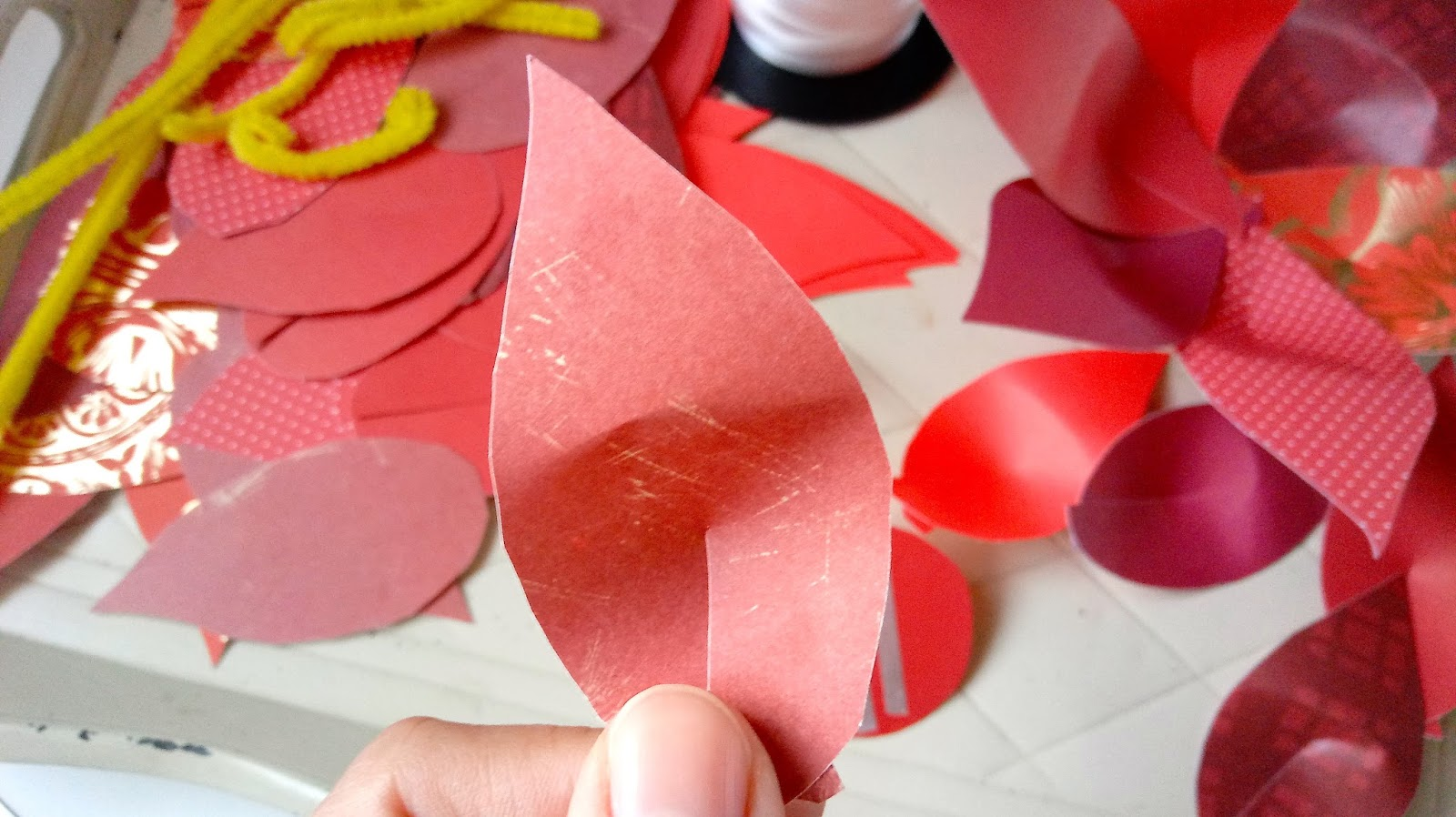 paper poinsettia These handcrafted blooms are ideal for embellishing wrapped gifts or fastening to a tree.