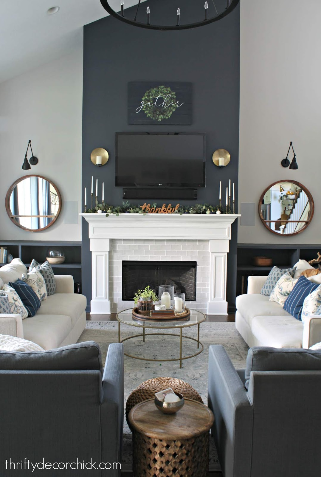 Dark blue accent wall on fireplace