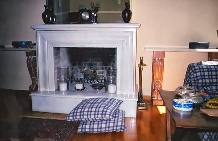 living room with white marble fireplace