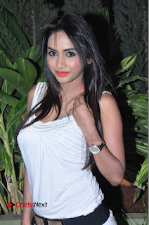 Actress Model Pooja Sri Stills in White Short Dress at F Club pre soft Launch  0010.JPG