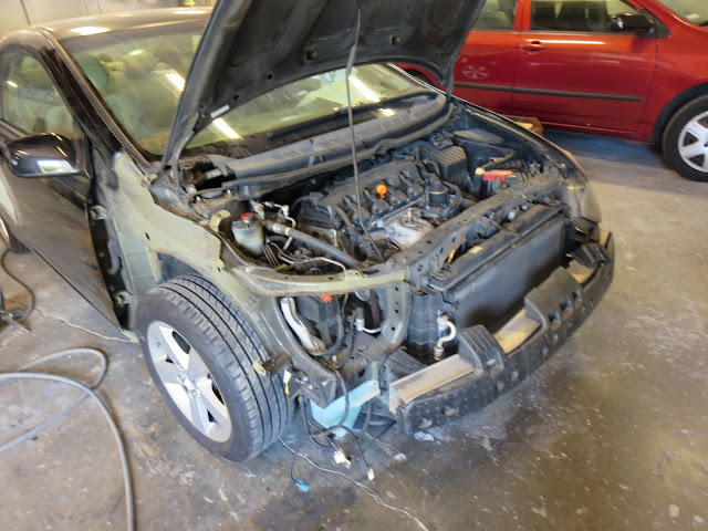 Honda Civic in process of collision repairs at Almost Everything Auto Body.