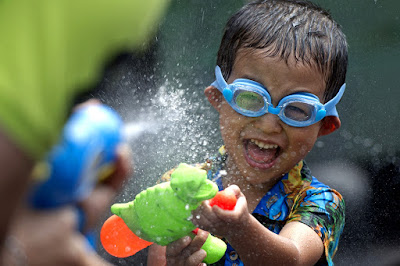 Funny child water pistol present joke picture