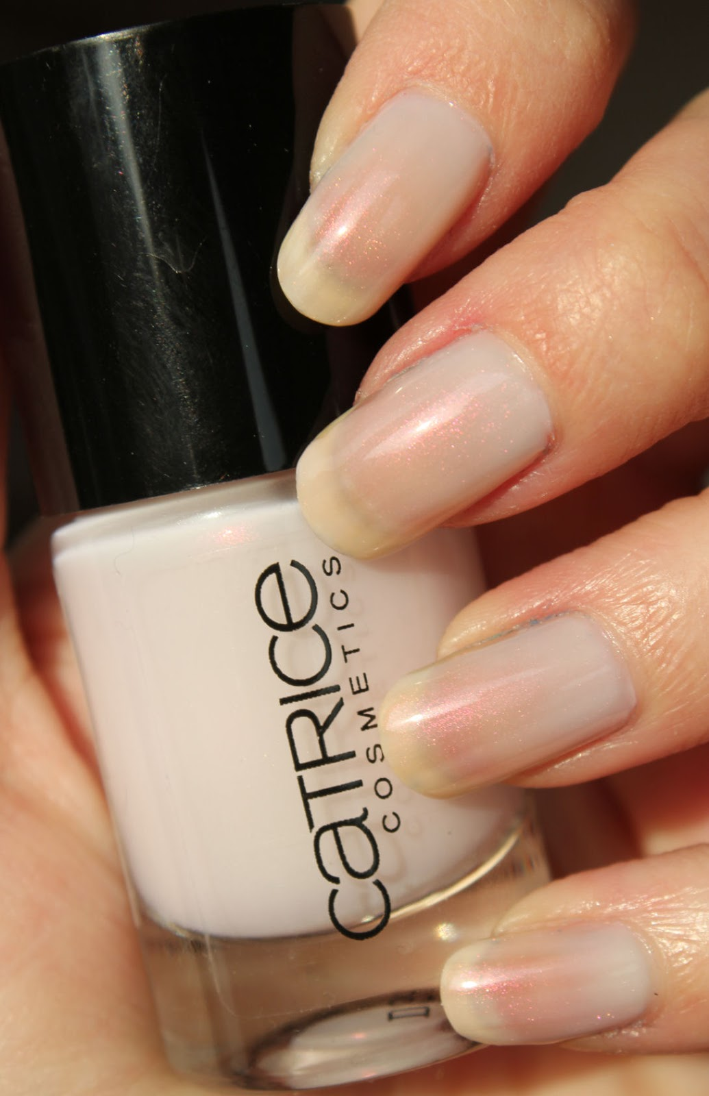 http://lacquediction.blogspot.de/2014/02/catrice-ultimate-nail-lacquer-58-meet.html