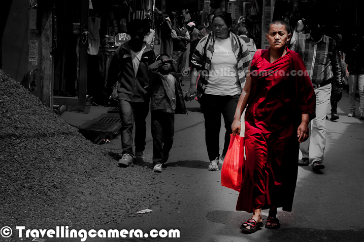 Few days back when Petrol prices were hiked in India, we started getting various jokes on our facebook wall. One of the joke was about the intelligence of Monk who sold his Ferrari. Suddenly I also thought of sharing this walking Monk in the streets of Mcledoganj town, which is in Himalayan State of India. Most of the streets of Mcledoganj can be seen with various Monks and Tourists roaming around. This photograph was clicked during one of my last trips to Mcledogaj and more can be seen at - http://phototravelings.blogspot.com/2012/05/walking-streets-of-mcledoganj-streets.html