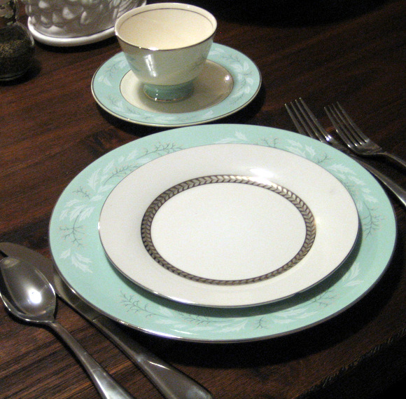 This turquoise china with silver accents is so sweet.