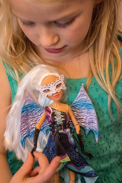 The Camryn Project Mc2 doll is being held by the hand with a wrist that can actually move
