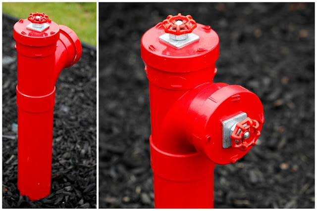 Fake fire hydrant pee post for dogs mounted in the garden