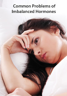 Woman with insomnia experiencing one of the common problems of imbalanced hormones