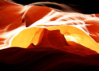 The allure of Antelope Canyon is the stunning photography that can be shot there. Antelope Canyon is a slot canyon, so it is very narrow. It was jammed packed with hundreds of amateur and professional photographers. Most of our pictures didn't turn out. We really needed a tripod to use the camera settings required to shoot the canyon. This one did, though, and I love it! It was shot up through the ceiling of the canyon. It's supposed to look like Monument Valley.