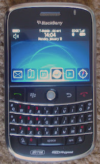 Blackberry cell phone with keyboard buttons and screen