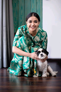 Keerthy Suresh in Green with Cute and Awesome Smile with a Cute Dog