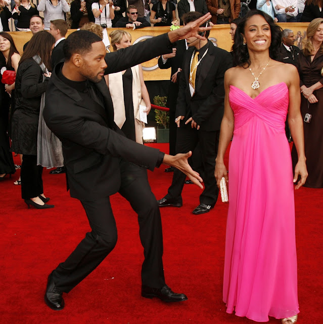 Will and Jada Smith on the red carpet. Most guys usually hold their date's hand and smile. . . then there is Will. Shablam!
