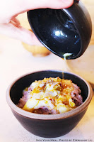 Pouring a Poached Egg over Six Grain Rice with Bonito Flakes Soaked in House Soy Sauce and Sesame Oil at Okonomi