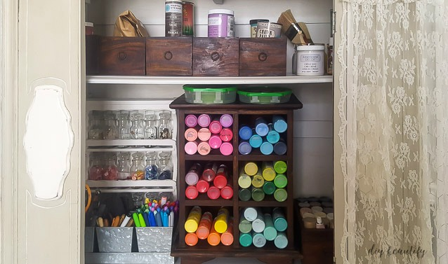 organizing supplies inside a hutch or cabinet