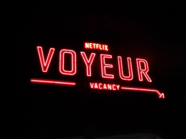 Netflix Voyeur vacancy neon sign billboard night