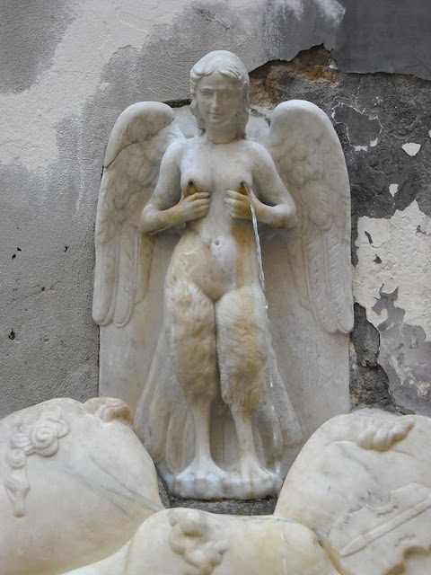The Parthenope Siren with viola on Vesuvius.  The Spinacorona fountain 16th century in Naples
