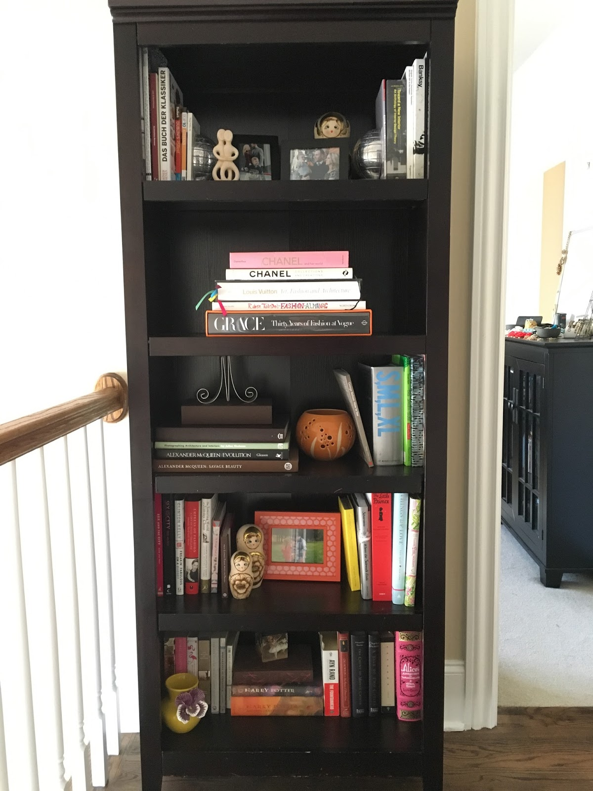 A Bookshelf Outside Of The Master Bedroom Houses Some Our Favorite Books As Well Items Weve Collected On Travels Including Guidebooks With