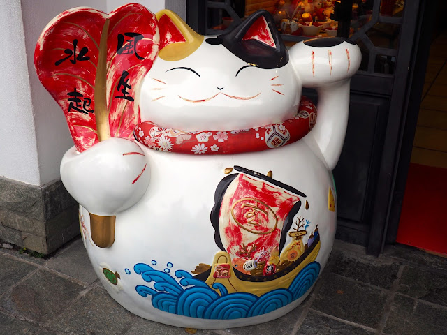 Funny fat cat statue with Chinese designs in Ngong Ping village, Lantau Island, Hong Kong