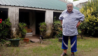 The World's Poorest President and his popular three-legged dog.