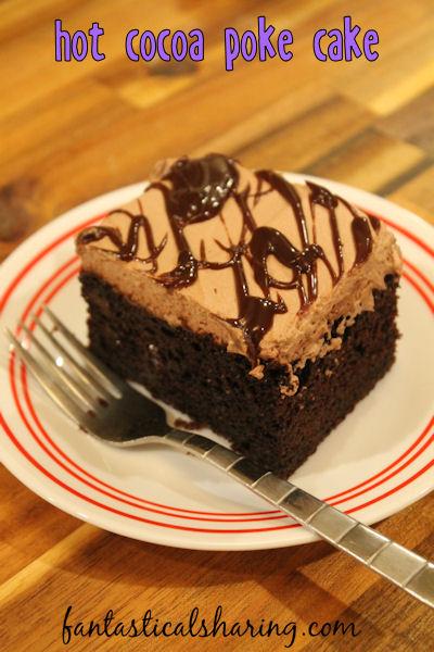 Hot Cocoa Poke Cake // Rich chocolate cake topped with hot fudge sauce and decadent cocoa whipped cream - tastes like heaven #recipe #cake #pokecake #chocolate #Choctoberfest