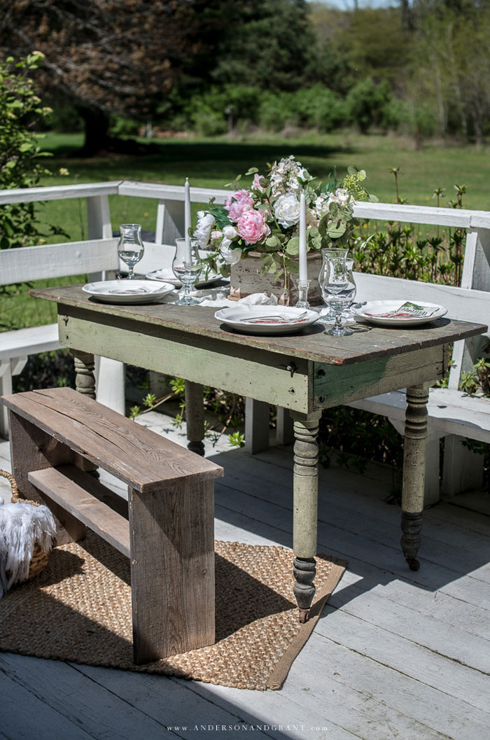 Green table decorated for summer dining