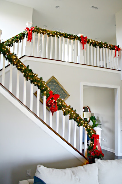 Greenery attached under stair railing