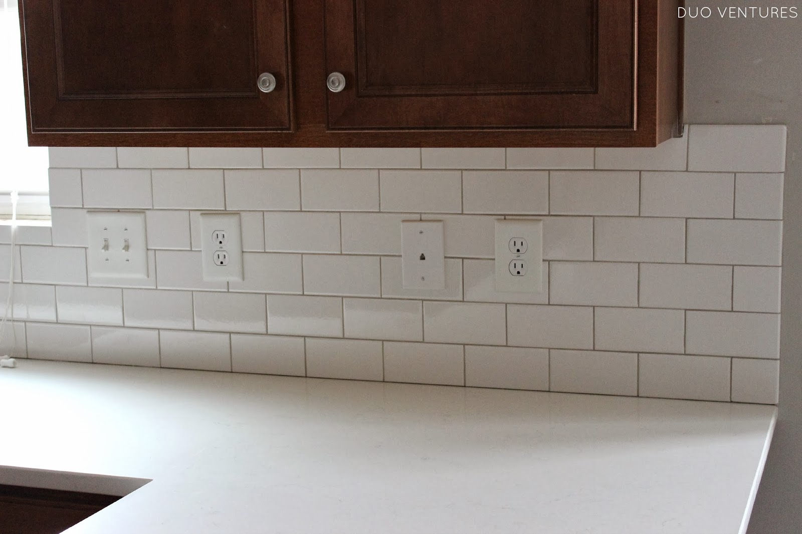 Off White Subway Tile Duo Ventures Kitchen Update Grouting Amp Caulking Subway