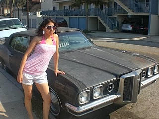 A retro girl with a vintage car outdoors