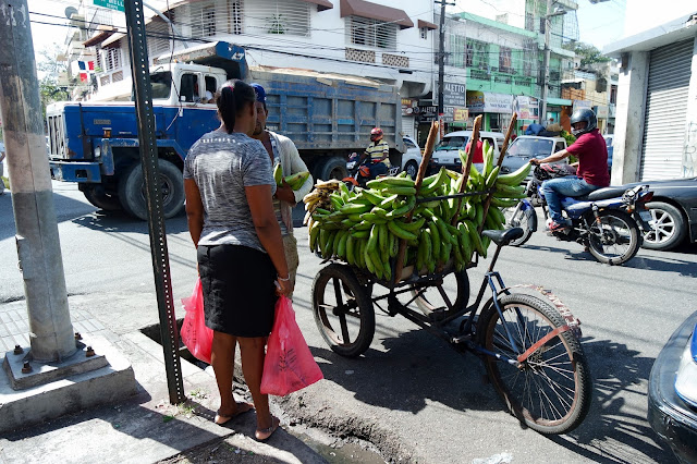 Plantain carts and motorcycles. This is Santo Domingo.