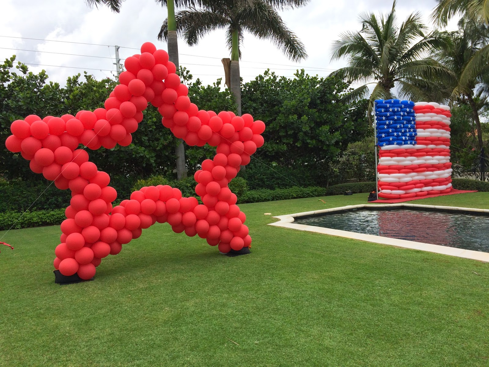 Red star and American flag by balloons for photoshoot