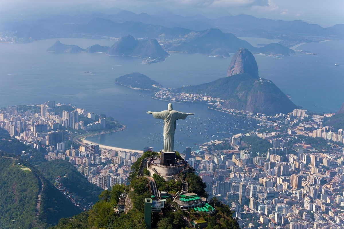 Christ the Redeemer Statue, standing proudly over Rio de Janeiro, Brazil. - The Seven Wonders Of The World Look Totally Different In These Unique Photos.