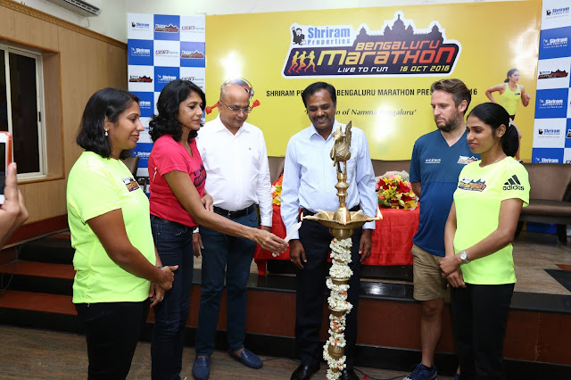 (L to R) Ms. Nisha Millet, Indian Olympic Swimmer, Ms. Reeth Abraham, Brand Ambassador - SPBM, International athlete and Arjuna Awardee, Mr. Nagaraj Adiga, Race Director, Mr. M Murali, Managing Director, Shriram Properties, Mr. Tom Naylor, Technical Race Director, Brighton Marathon, UK and Ms. Sudha Singh, Indian Olympic Runner lighting the lamp at the Press Conference.