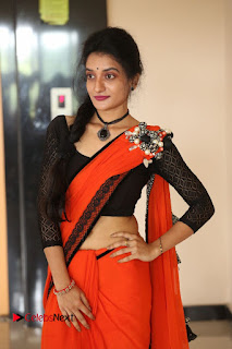 Janani Reddy looks cute in Orange saraee and black blouse