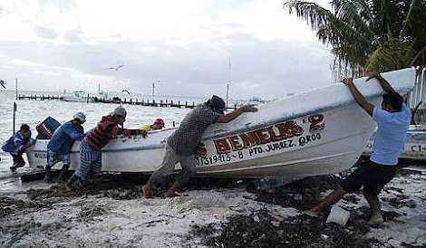 Fishermen secure their boat