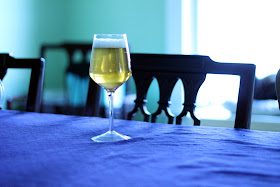 A glass of wine barrel solera, dry hopped with Citra, Mosaic, and Nelson Sauvin.
