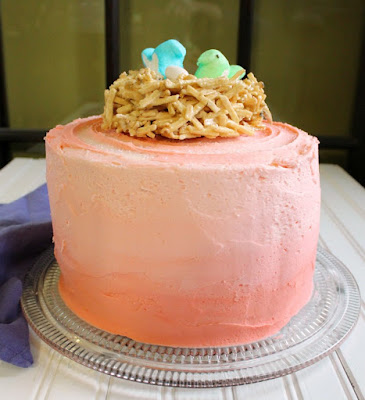 pink ombre layer cake with edible nest and peeps topper