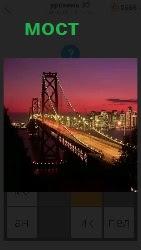 освещенный мост через речку в вечернее время
