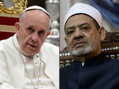 Pope and top imam embrace in historic meeting at Vatican