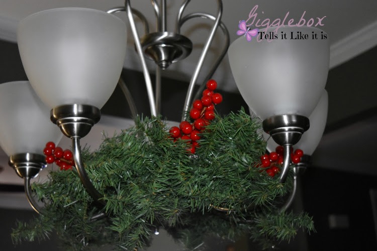 A simple and elegant way to decorate the dinning room chandelier for decorating a dinning room chandelier for christmas simple and elegant way to decorate a chandelier aloadofball Image collections