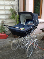 film playing inside old fashioned pram