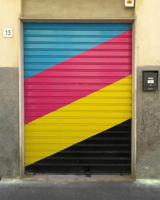 A CMYK shutter in Via Fagiuoli, Livorno