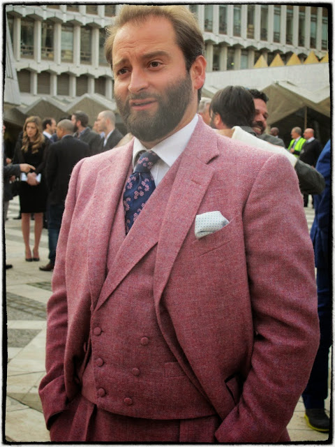 Wine Chap wearing a glorious pink suit.