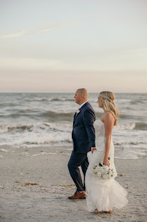 bride and groom walking on sanibel island beach